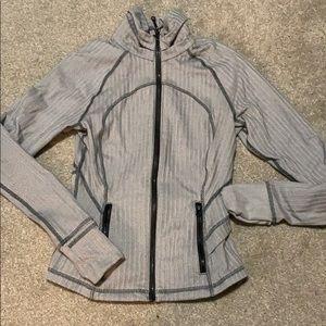 Gray and white lululemon peplum jacket
